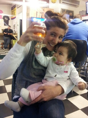 My friend's baby is already a hophead -- reaching for the Bell's Hopslam at Al's of Hampden.