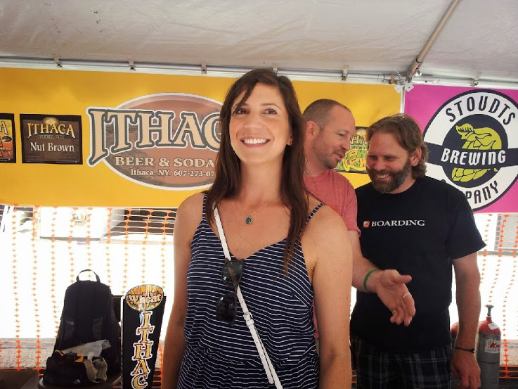 """Sara wears her favorite """"fest dress"""" and crossbody bag while pouring at last year's Harrisburg Brewers Fest."""